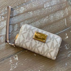 Michael Kors monogram wristlet wallet white & gold